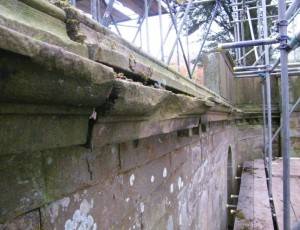 Stone cornice prior to restoration.